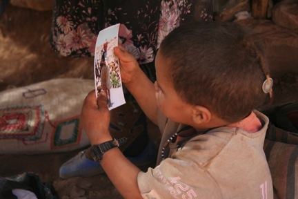 morocco boy looks at photo