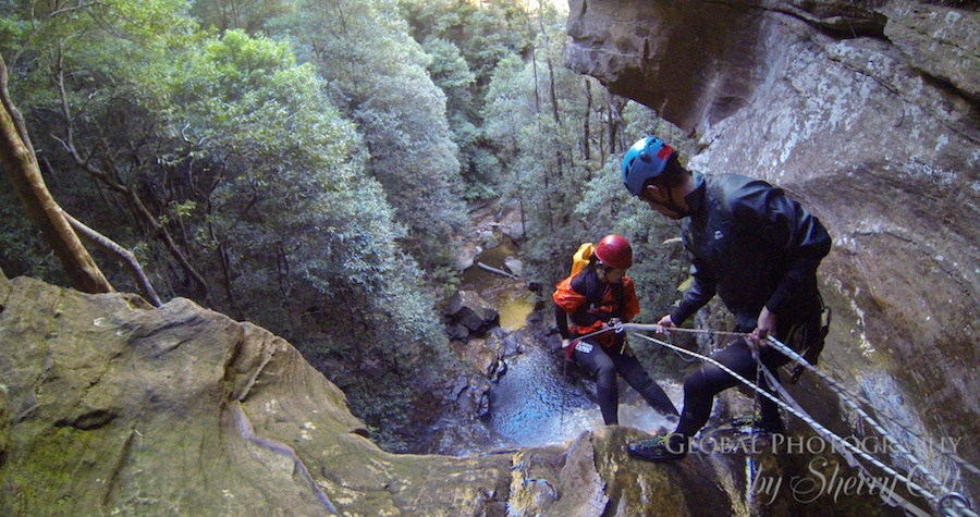 Brave - repelling down a waterfall in Australia
