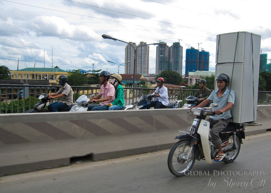 Don't Judge - carrying a fridge on a motorbike in Vietnam