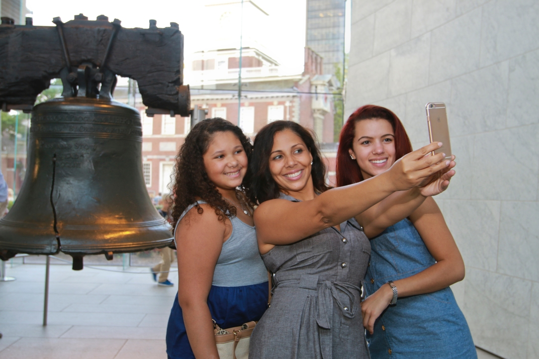 The Liberty Bell provides the perfect backdrop for a selfie. Every year, millions of visitors pour into the free Liberty Bell Center to see the famously cracked icon in person. Photo: D. Cruz for VISIT PHILADELPHIA™