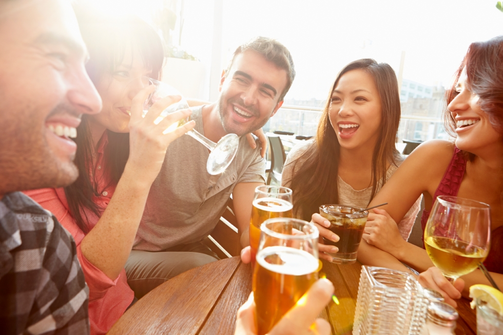 Group Of Friends Enjoying Drink At Outdoor Rooftop Bar. Credit: istock