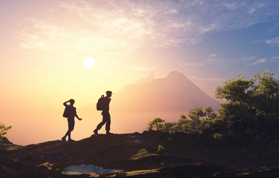 Silhouette of people near the mountain.